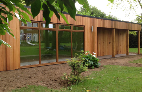Gyms and saunas bathstone garden rooms for Garden shed gym
